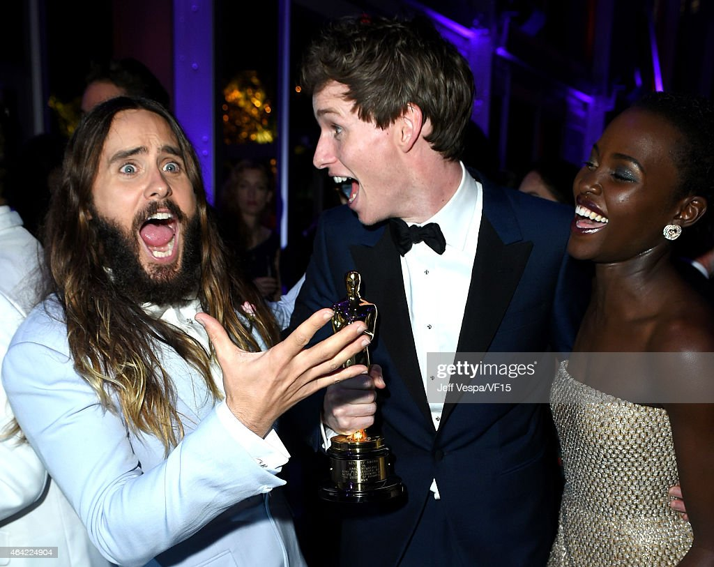 Actors Jared Leto, Eddie Redmayne, and Lupita Nyong'o attend the 2015 Vanity Fair Oscar Party hosted by Graydon Carter at the Wallis Annenberg Center for the Performing Arts on February 22, 2015 in Beverly Hills, California.