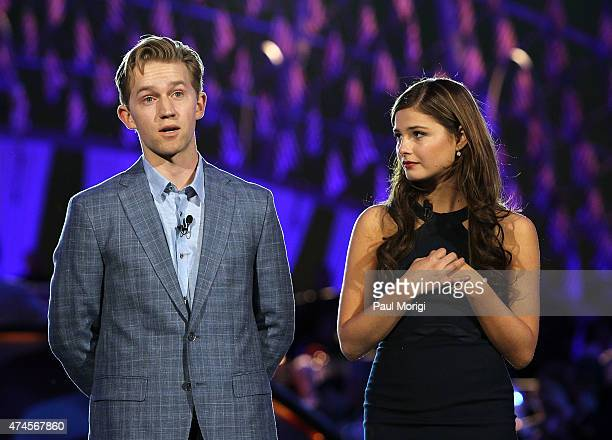 Actors Jason Dolley and Stefanie Scott on stage at the 26th National Memorial Day Concert Rehearsals on May 23 2015 in Washington DC