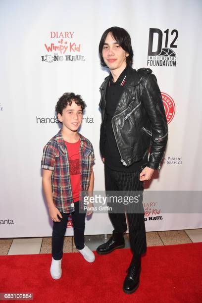 Actors Jason Drucker and Charlie Wright attend Diary Of A Wimpy Kid The Long Haul Atlanta screening hosted by Dwight Howard at Regal Atlantic Station...