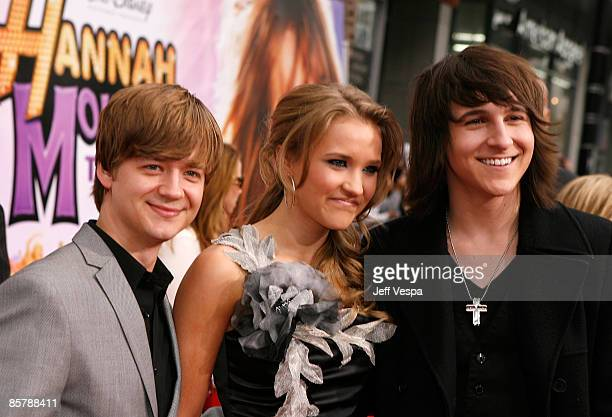 Actors Jason Earles Emily Osment and Mitchell Musso arrive at the premiere of Walt Disney Picture's Hannah Montana The Movie held at the El Captian...