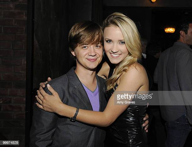 LOS ANGELES CA MAY 16 Actors Jason Earls and Emily Osment attend the Hannah Montana Wrap Party at H Wood on May 16 2010 in Los Angeles California