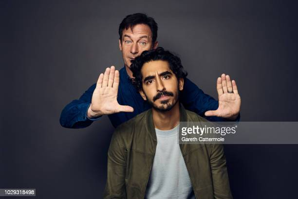 Actors Jason Isaacs and Dev Patel from the film 'Hotel Mumbai' pose for a portrait during the 2018 Toronto International Film Festival at...