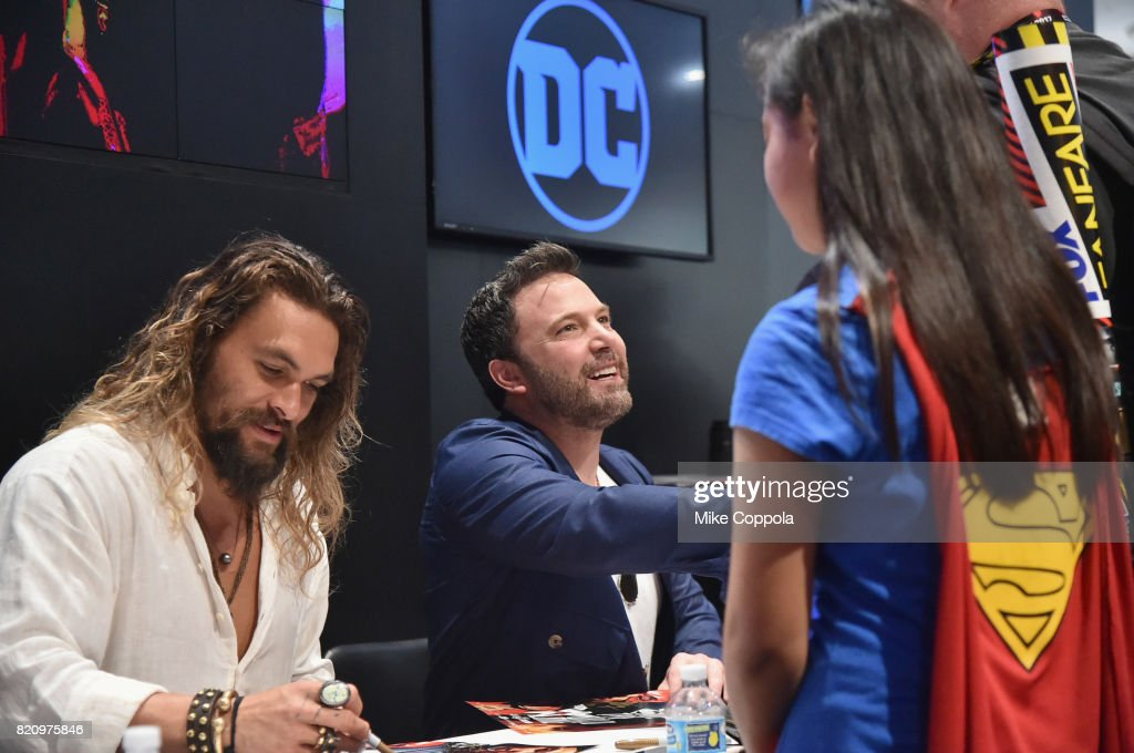 Actors Jason Momoa (L) and Ben Affleck greet fans during the 'Justice League' autograph signing at Comic-Con International 2017 at San Diego Convention Center on July 22, 2017 in San Diego, California.