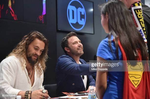 Actors Jason Momoa and Ben Affleck greet fans during the 'Justice League' autograph signing at ComicCon International 2017 at San Diego Convention...