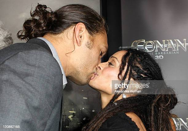 Actors Jason Momoa and Lisa Bonet attend the world premiere of Conan The Barbarian held at Regal Cinemas LA Live on August 11 2011 in Los Angeles...