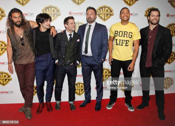 Actors Jason Momoa Ezra Miller director Zack Snyder actors Ben Affleck Ray Fisher and Henry Cavill attend the Warner Bros Pictures presentation...