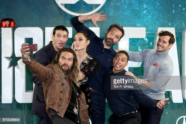 Actors Jason Momoa Ezra Miller Gal Gadot Ben Affleck Ray Fisher and Henry Cavill attend the 'Justice League' photocall at The College on November 4...