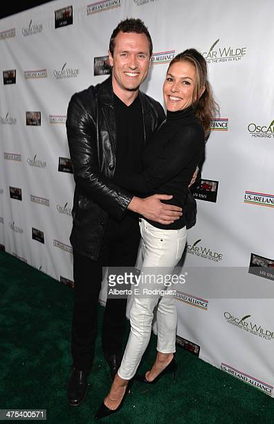 Actors Jason O'Mara and Paige Turco attend the 9th Annual 'Oscar Wilde Honoring The Irish In Film' PreAcademy Awards event at Bad Robot on February...