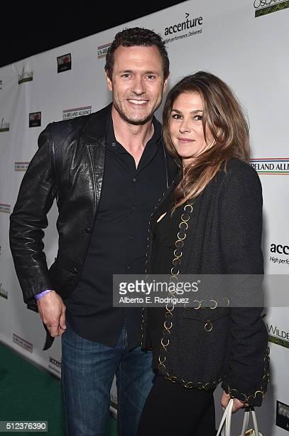 Actors Jason O'Mara and Paige Turco attend the Oscar Wilde Awards at Bad Robot on February 25 2016 in Santa Monica California