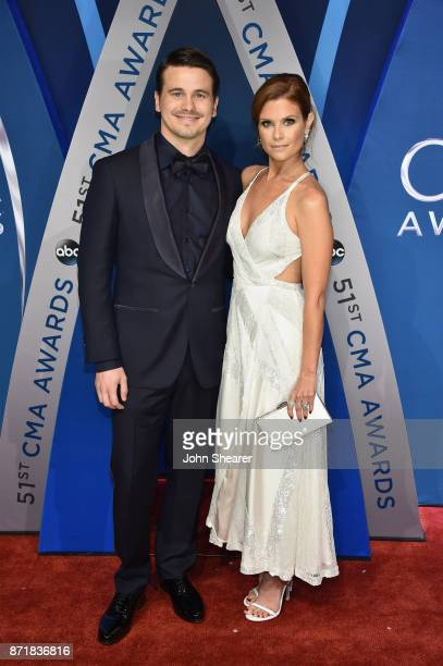 Actors Jason Ritter and JoAnna Garcia Swisher attend the 51st annual CMA Awards at the Bridgestone Arena on November 8 2017 in Nashville Tennessee