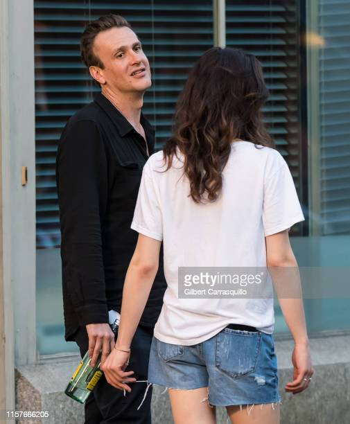 Actors Jason Segel and Eve Lindley are seen filming on set of AMC's Dispatches from Elsewhere an upcoming American anthology television series...