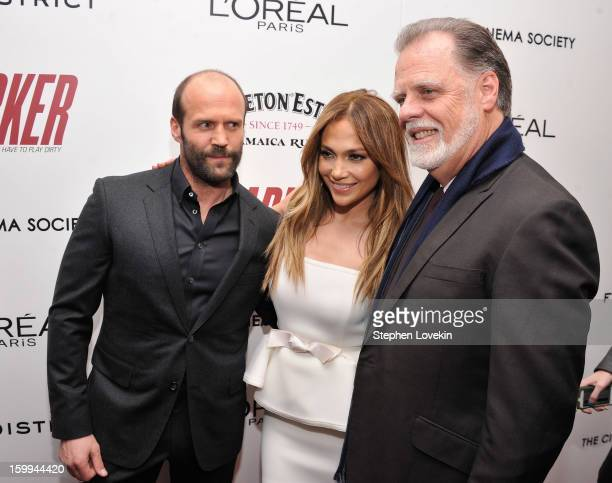Actors Jason Statham and Jennifer Lopez pose with Director Taylor Hackford at a screening of Parker hosted by FilmDistrict The Cinema Society L'Oreal...
