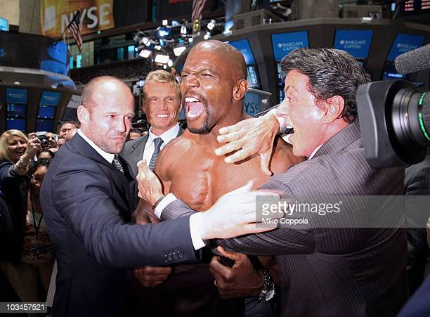 Actors Jason Statham, Dolph Lundgren, Terry Crews, and Sylvester Stallone pose for pictures after ringing the opening bell at the New York Stock...