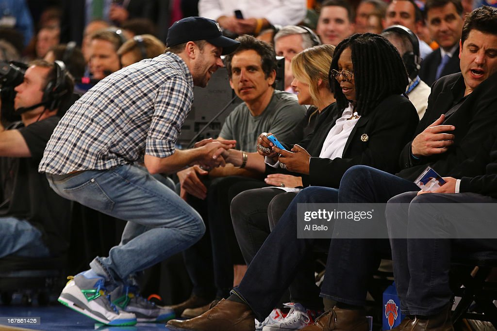 Actors Jason Sudeikis, Ben Stiller, Christine Taylor, and Whoopi Goldberg talk during Game five of the Eastern Conference Quarterfinals of the 2013 NBA Playoffs between the New York Knicks and the Boston Celtics at Madison Square Garden on May 1, 2013 in New York City.