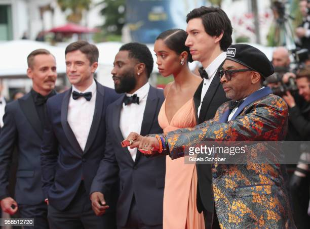 Actors Jasper Paakkonen Topher Grace John David Washington Laura Harrier Adam Driver and director Spike Lee wearing knuckle rings with love and hate...
