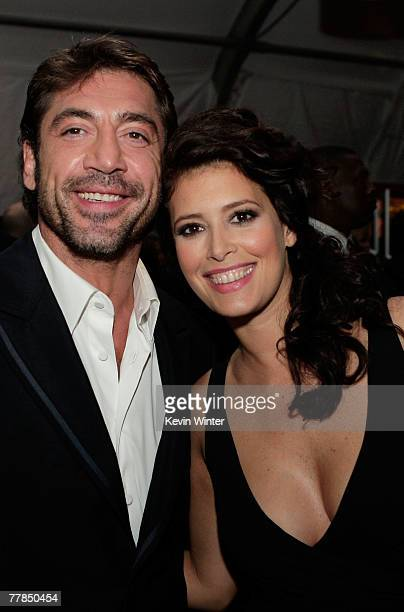 """Actors Javier Bardem and Angie Cepeda pose for photos during the closing night gala after party for """"Love In The Time Of Cholera"""" during AFI FEST..."""