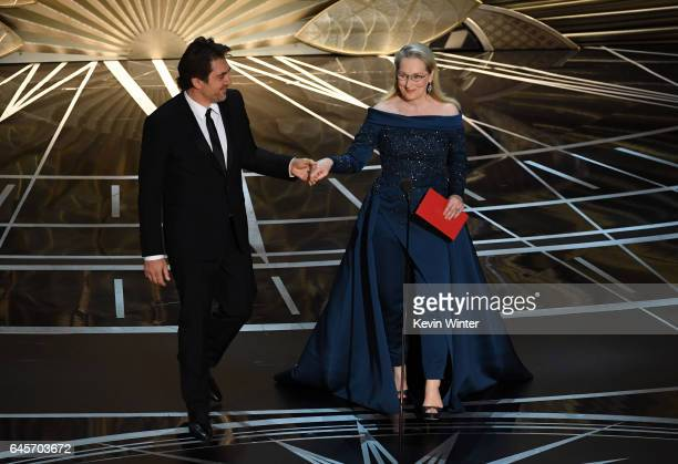Actors Javier Bardem and Meryl Streep speak onstage during the 89th Annual Academy Awards at Hollywood Highland Center on February 26 2017 in...
