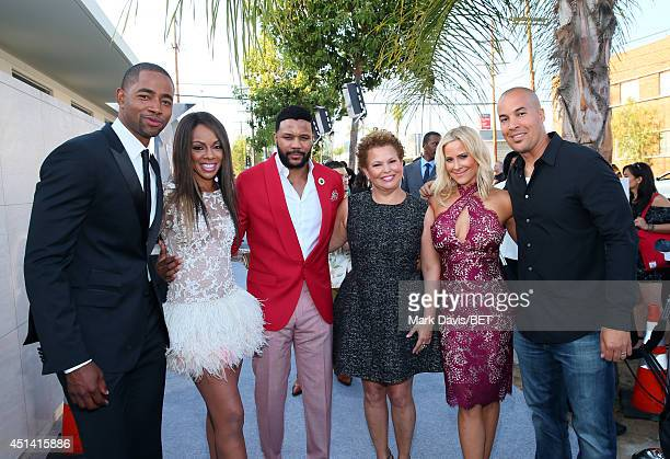 Actors Jay Ellis Wendy Raquel Robinson and Hosea Chanchez BET Chairman CEO Debra L Lee actors Brittany Daniel and Coby Bell attend the BET AWARDS '14...