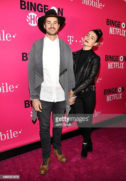 Actors Jayson Blair and Allison Paige attend TMobile Uncarrier X Launch Celebration at The Shrine Auditorium on November 10 2015 in Los Angeles...