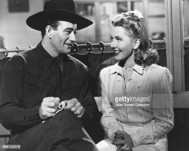 Actors Jean Arthur as Molly J Truesdale and John Wayne as Duke Hudkins in the romantic comedy 'A Lady Takes a Chance' 1943