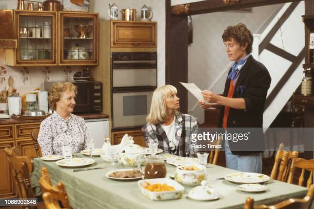 Actors Jean Boht Rita Tushingham and Jonathan Morris in a kitchen scene from the BBC television sitcom 'Bread' August 21st 1988