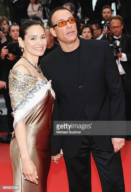 """Actors Jean Claude Van Damme and Gladys Portugues attend the """"You Will Meet A Tall Dark Stranger"""" Premiere at the Palais des Festivals during the..."""