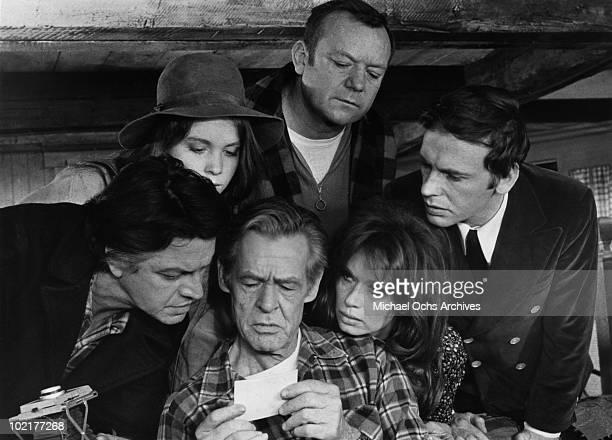 Actors Jean Gavin, Tisa Farrow, Robert Ryan, Aldo Ray, Lea Massari and Jean-Louis Trintignant in a scene from the movie 'And Hope to Die' in 1972 in...