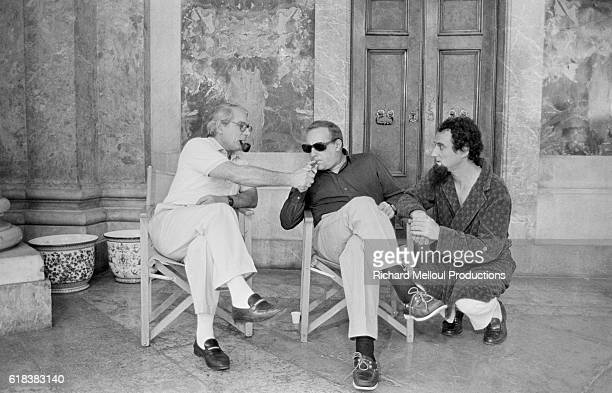 Actors Jean Poiret Michel Serrault and Daniel Prevost relax with pipes and cigars while filming the 1985 movie Liberte Egalite Choucroute French...