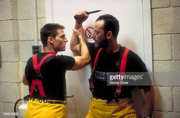 Actors Jean Reno as Franz Krieger and Tom Cruise as Ethan Hunt in a scene from the film 'Mission Impossible' 1996 Here Hunt prevents Krieger from...