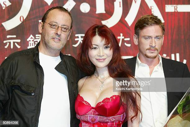 Actors Jean Reno Mika Kano and Benoit Magimel attend a press conference to promote Crimson River 2 on May 25 2004 in Tokyo Japan The film will open...
