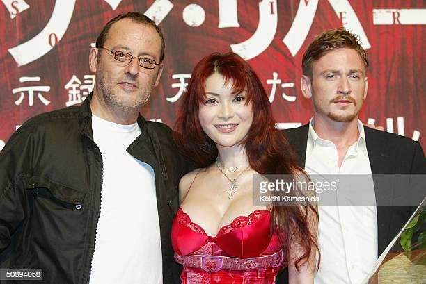 Actors Jean Reno Mika Kano and Benoit Magimel pose at a press conference to promote Crimson River 2 on May 25 2004 in Tokyo Japan The film will open...