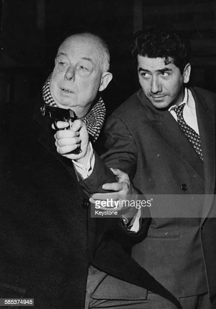 Actors Jean Renoir directing fellow actor Daniel Gelin during rehearsals for the play 'Le Grand Couteau' at the Bouffes Parisiens Theatre in Paris...