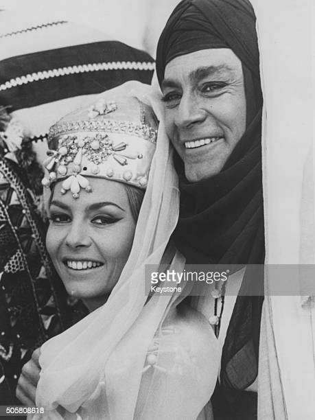 Actors Jean-Claude Pascal and Michele Mercier in costume on the set of the film 'Untamable Angelique', circa 1967.