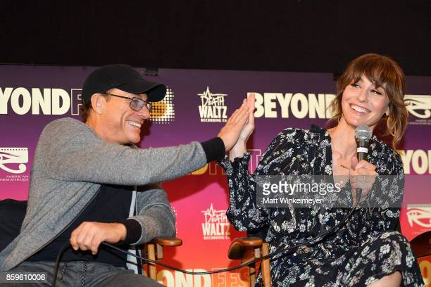 Actors JeanClaude Van Damme and Kat Foster speak onstage during the Beyond Fest screening and Cast/Creator panel of Amazon Prime Video's exclusive...
