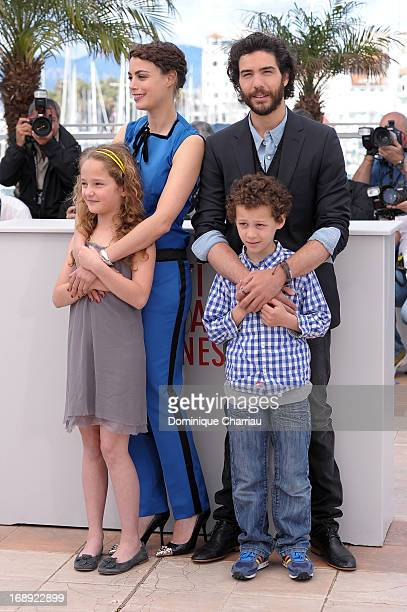 Actors Jeanne Jestin Berenice Bejo Tahar Rahim and Elyes Aguis attend the photocall for 'Le Passe' during the 66th Annual Cannes Film Festival at...
