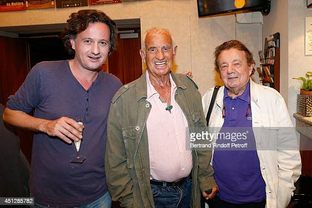 Actors JeanPaul Belmondo standing between Mathias Marechal and his father Marcel Marechal backstage after 'Le Cavalier seul' Theater Play at Theatre...