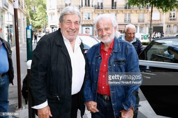 Actors JeanPierre Castaldi and JeanPaul Belmondo attend the Street Art butterflies by Charlotte Joly Exhibition Preview at Veramente on June 15 2018...