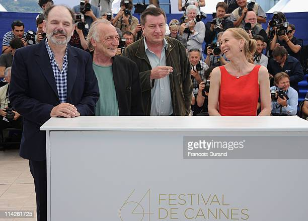 Actors JeanPierre Darroussin Blondin Miguel director Aki Kaurismaki and Kati Outinen attend the 'Le Havre' photocall at the Palais des Festivals...