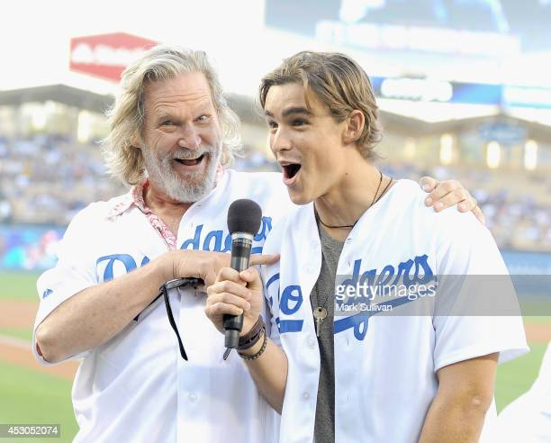 Actors Jeff Bridges and Brenton Thwaites before the game between the Chicago Cubs and Los Angeles Dodgers at Dodger Stadium on August 1 2014 in Los...