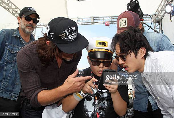 Actors Jeffrey Dean Morgan Norman Reedus Make A Wish Kid Ian Andrew Lincoln and Steven Yeun of The Walking Dead attend the IMDb Yacht at San Diego...