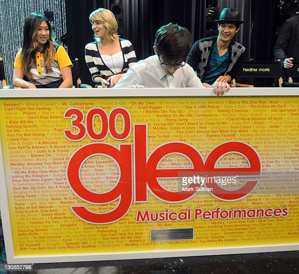 """Actors Jenna Ushkowitz, Dianna Agron, Kevin McHale and Harry Shum Jr. With the plaque commemorating the 300th musical performance on """"Glee"""" at..."""