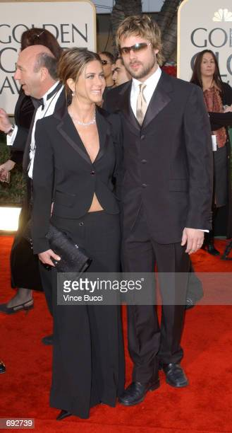 Actors Jennifer Aniston and Brad Pitt attend the 59th Annual Golden Globe Awards at the Beverly Hilton Hotel January 20 2002 in Beverly Hills CA