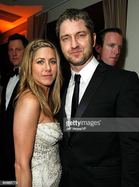 WEST HOLLYWOOD CA FEBRUARY 22 Actors Jennifer Aniston and Gerard Butler attend the 2009 Vanity Fair Oscar party hosted by Graydon Carter at the...