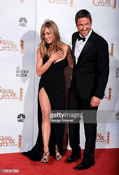 Actors Jennifer Aniston and Gerard Butler pose in the press room at the 67th Annual Golden Globe Awards at The Beverly Hilton Hotel on January 17...