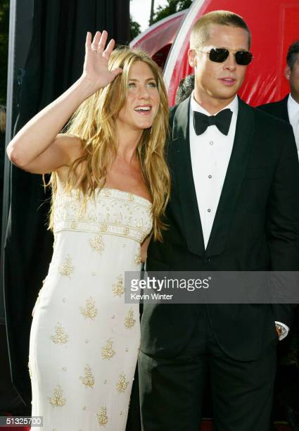 Actors Jennifer Aniston and husband Brad Pitt attend the 56th Annual Primetime Emmy Awards at the Shrine Auditorium September 19 2004 in Los Angeles...