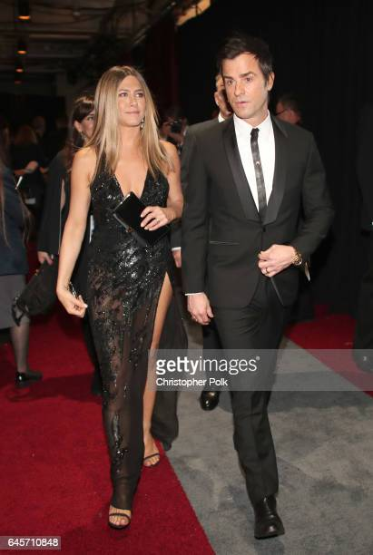 Actors Jennifer Aniston and Justin Theroux pose backstage during the 89th Annual Academy Awards at Hollywood Highland Center on February 26 2017 in...