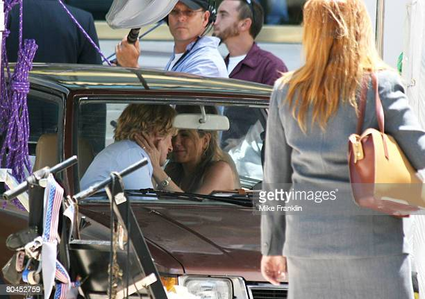 Actors Jennifer Aniston and Owen Wilson kiss on the set of Marley and Me on March 31 2008 in Miami Florida