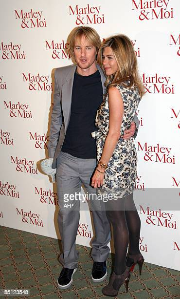 US actors Jennifer Aniston and Owen Wilson pose during a photocall as they promote their new movie Marley Moi by David Frankel on February 26 2009 in...