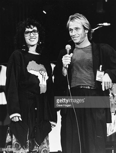 Actors Jennifer Beals and Corbin Bernsen on stage as presenters at the Nelson Mandela 70th Birthday Tribute concert at Wembley Stadium London June...