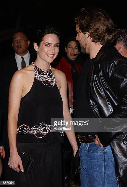 Actors Jennifer Connelly and Russell Crowe attend the premiere of the film 'A Beautiful Mind' December 13 2001 in Beverly Hills CA